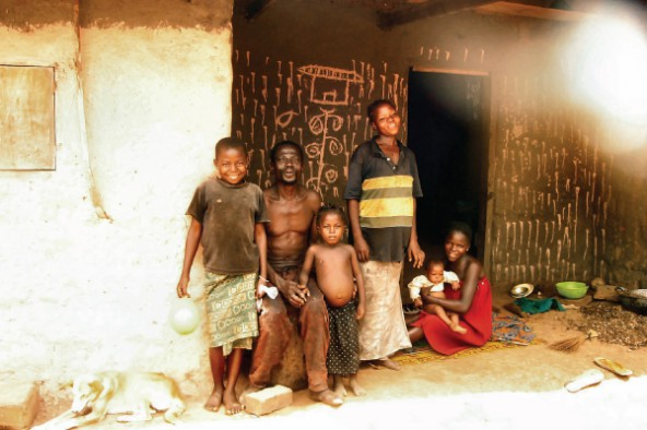 A visit to the rural home of a child (far left), who survived both TB and Burkitt's lymphoma