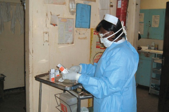 Sister Julia mixing anticancer drugs on Children's ward, Banso Baptist Hospital